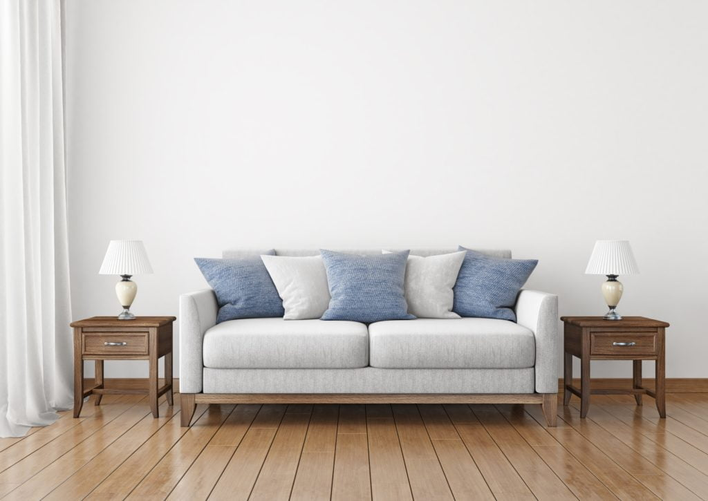 Light Gray Fabric Couch with Blue and Pale Gray Throw Pillows