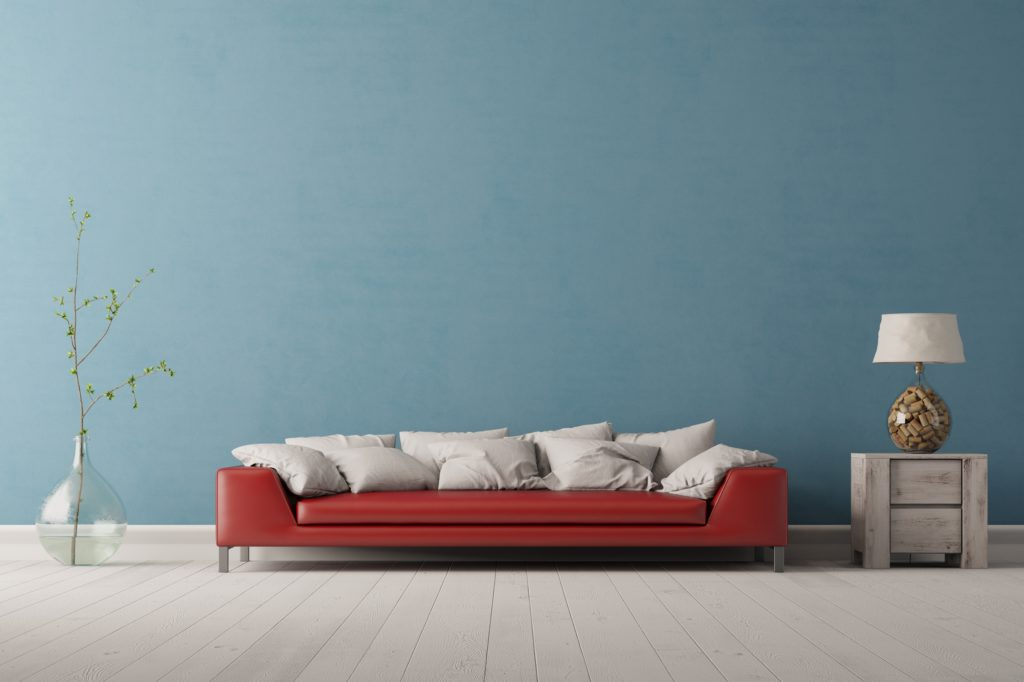 Long Red Sofa Before Soft Aqua Wall with White Pillow Clusters