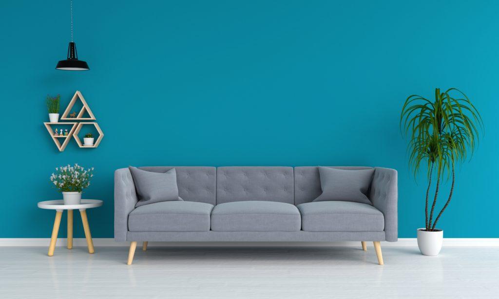 Modern Gray Sofa and Pillows Against Deep Aqua Living Room Wall