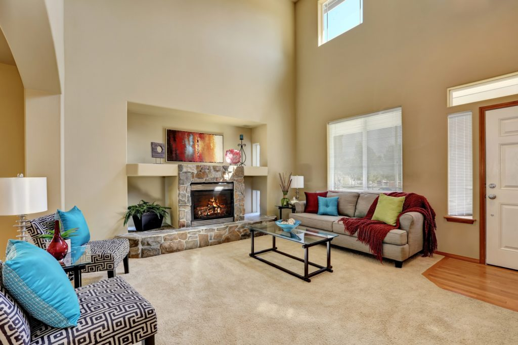 Modern Living Room Stone Fireplace and Geometric Patterned Fabric Chair