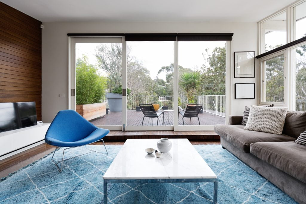 Modern Scandinavian Living Room in Blue and Cocoa with Mid century Diamond Chair