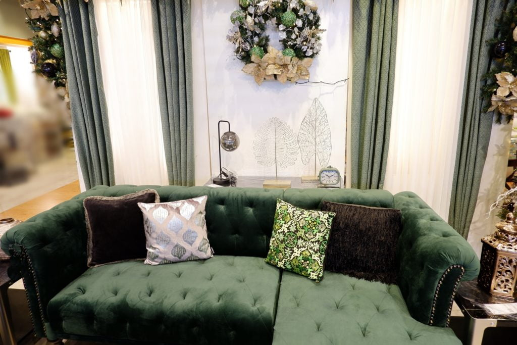 Palatial-Inspired Deep Evergreen Sofa Made of Opulent Tufted Velvet Features Dark-Brown, Silver/White & Green/White Leafy Patterned Decorative Pillows