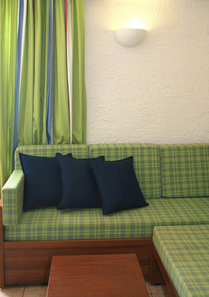 Refreshing Green Plaid Couch with Wooden Frame Gets a Cozy Vibe with Darker Blue Pillows