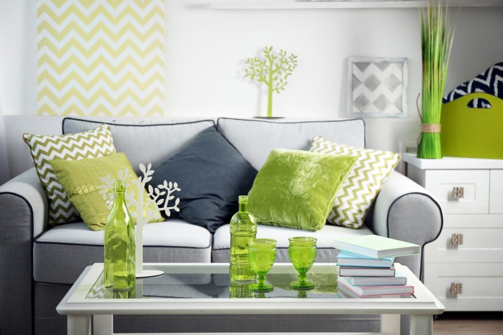 Retro Gray Couch Featuring Spring Green Pillows in a Cluster