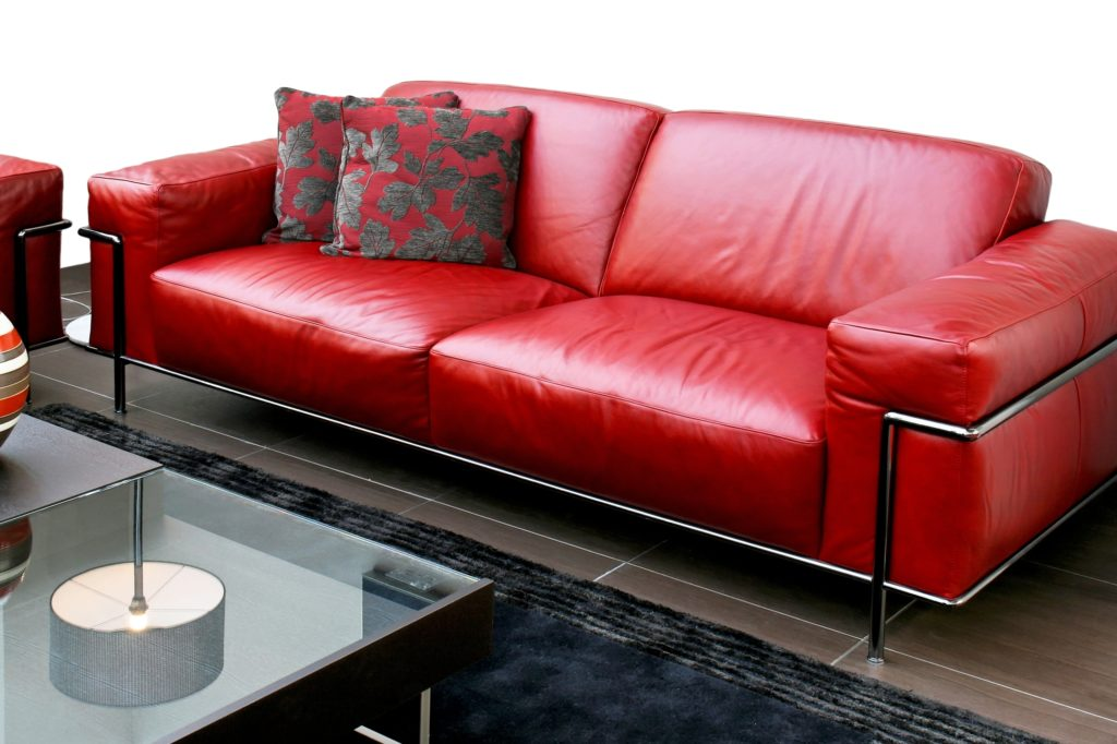 Shiny Red Sofa with Pillow Décor in Modern Living Room