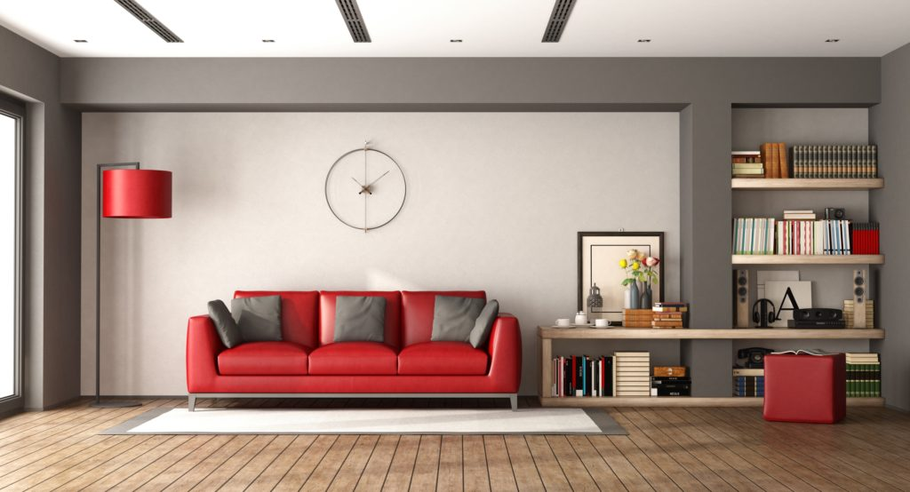 Sleek Contemporary Red Leather Sofa with Grey Pillows and Wooden Bookcase