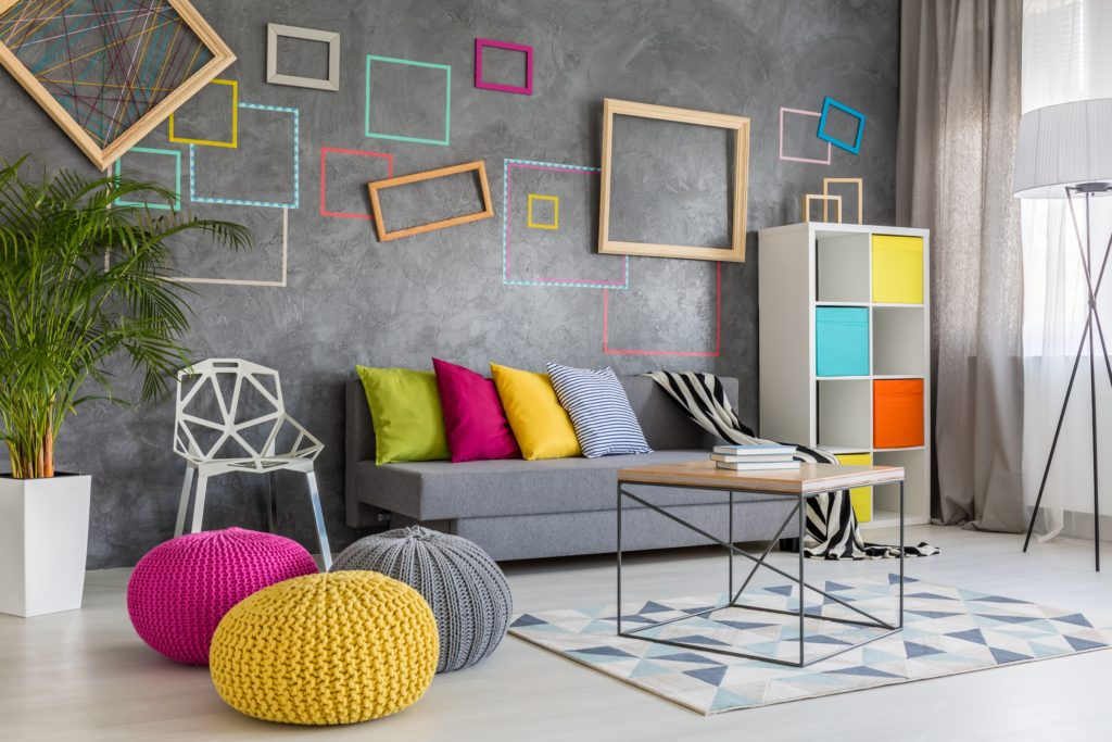 Spacious Home Lounge with Gray Couch Bright Pillows and Colorful Poufs