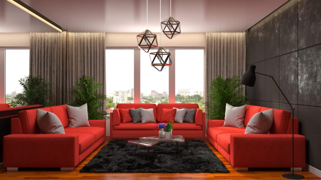 Spacious Living Room with Three Red Sofas and Decorative Pillows