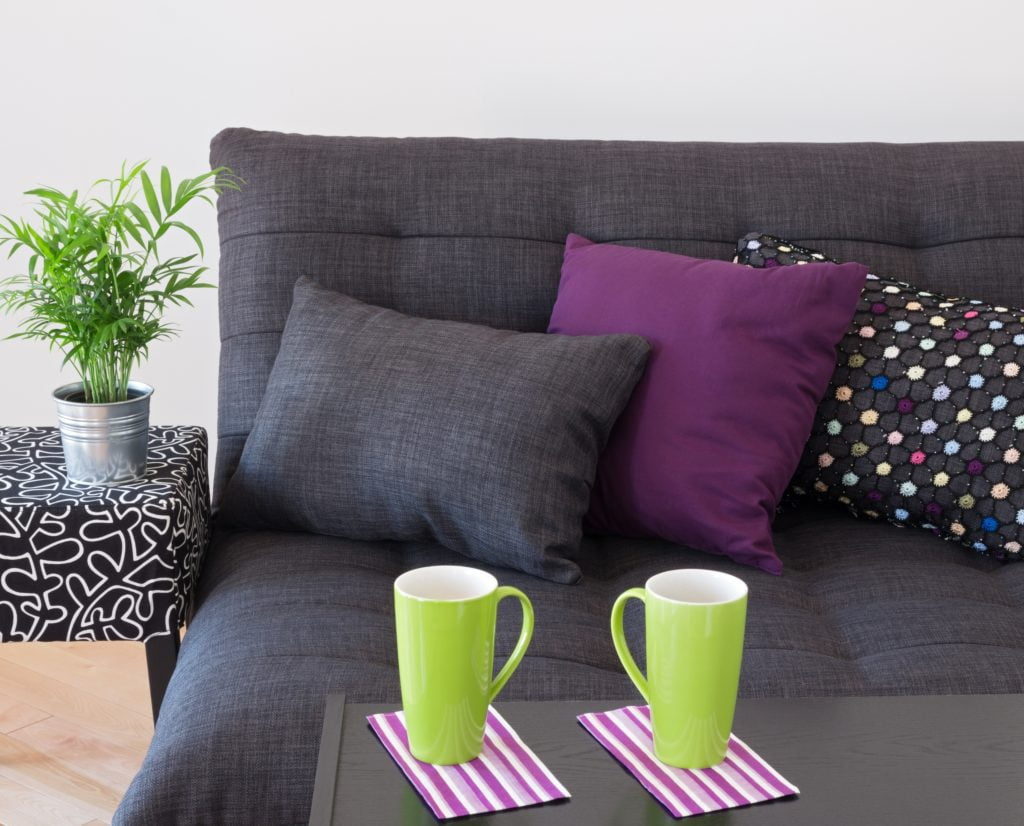 Stunning Charcoal Gray Living Room Sofa with Multi Colored Pillows