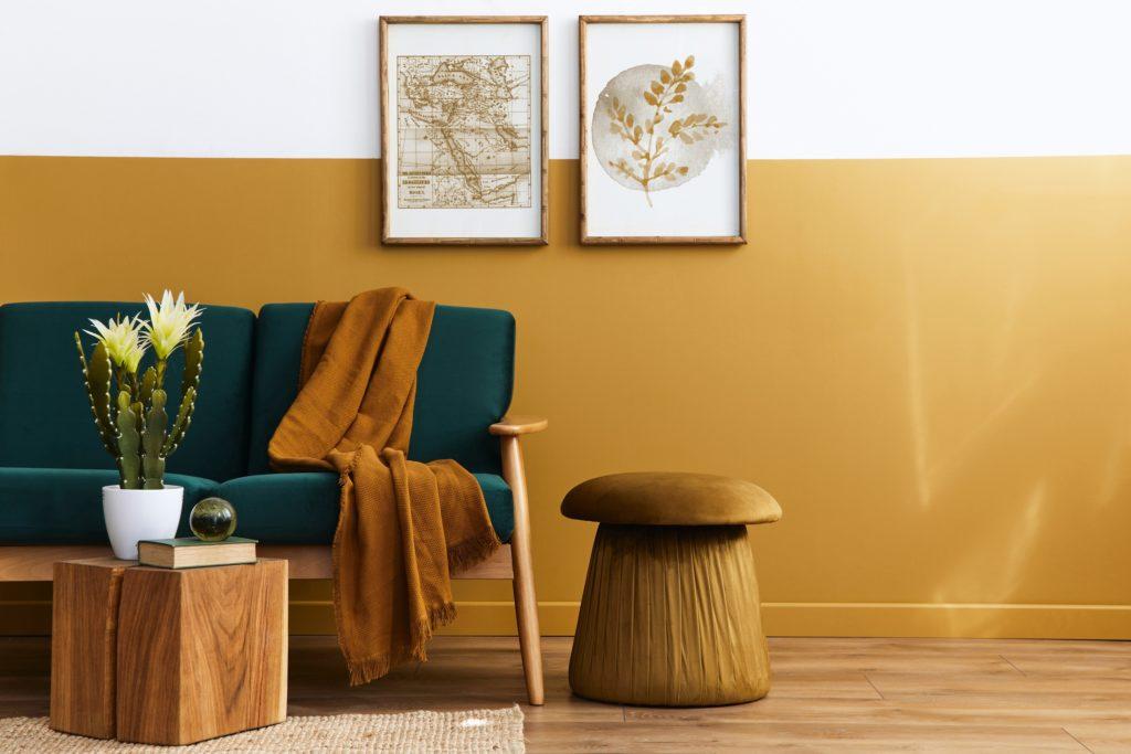 Velvet Deep Forest Green Couch Featuring Warm Golden Tan Hues in Scandinavian Design Style