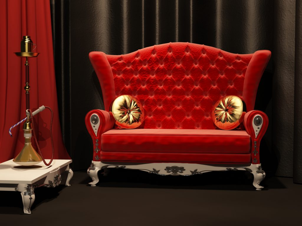 Vintage Style High Backed Red Sofa with Gold Pillows and Decorative Hookah