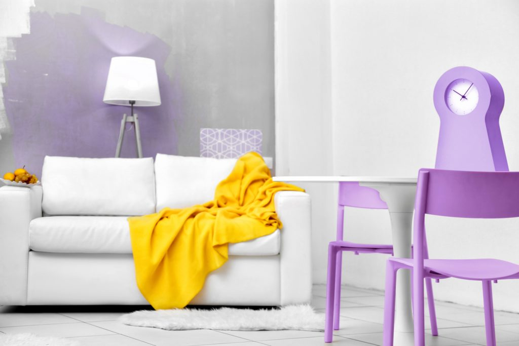 White and Grey Living Room with Folding Violet Accent Chairs