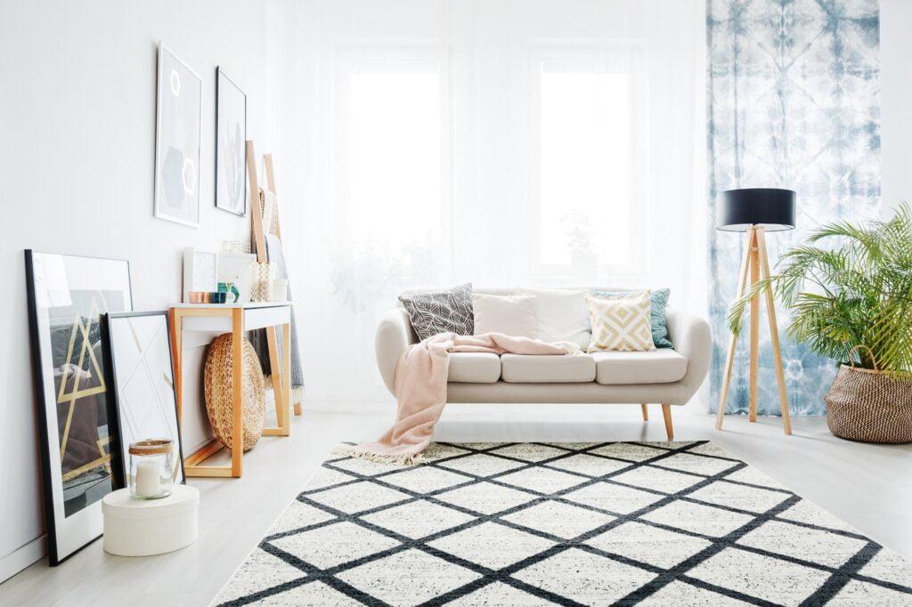 Bright Modern Boho Living Room with Beige Sofa and Bold Rug Design