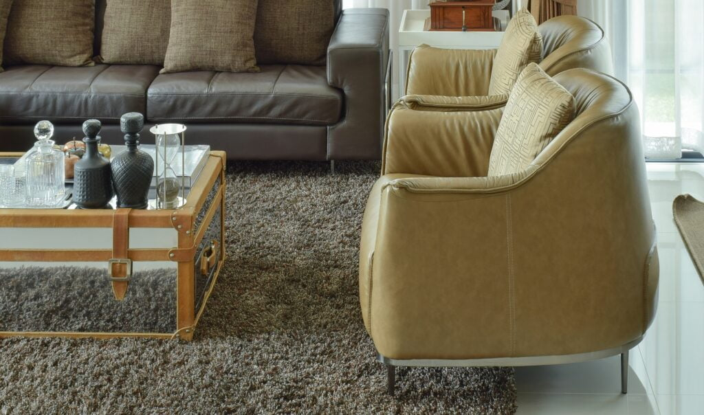 Brown Den Sofa with Mustard Armchairs and Cocoa Rug