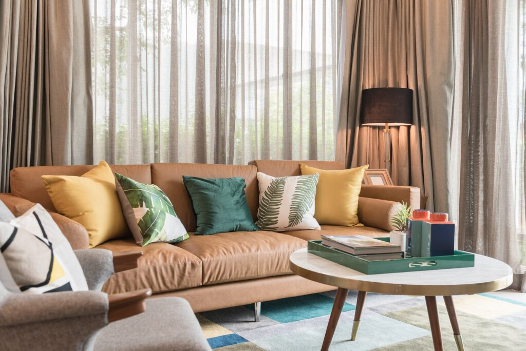 Brown Sofa in Modern Living Room with Colorful Pillows and Carpeting