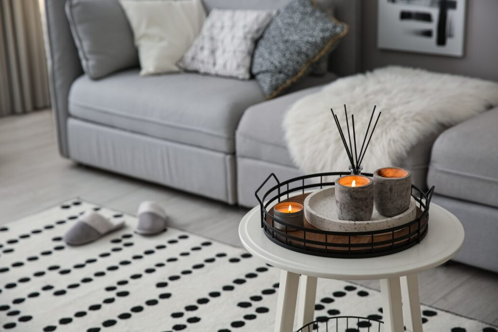 Casual Den Interior with Gray Sofa and Black and White Polka dot Rug