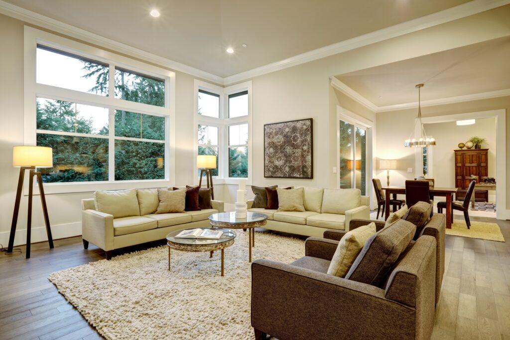 Chic Large Neutral Living Room Design with Elegant Dark Brown Sofa