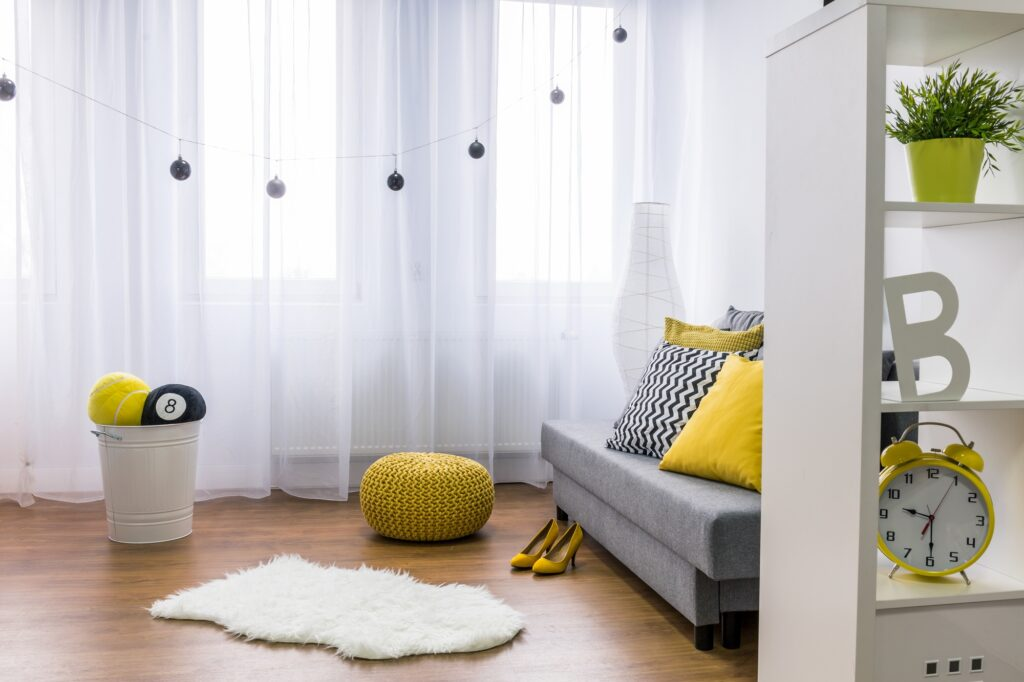 Chic Living Room with Gray Couch Filmy Curtains and White Shag Rug