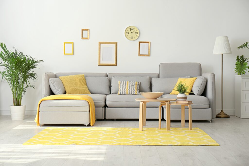 Comfortable Family Room with Gray Couch and Yellow Gold Accents