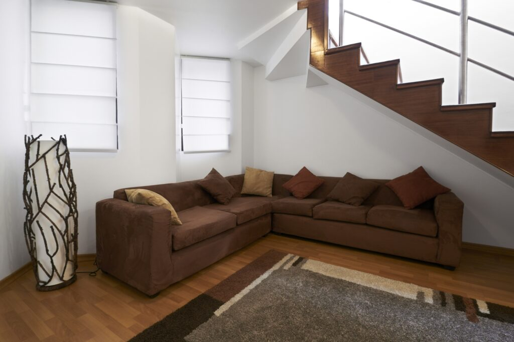 Contemporary Family Room with Brown Corner Sectional Couch