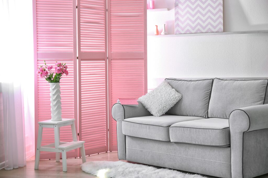 Family Room Decor with Light Gray Couch and Pink Folding Screen