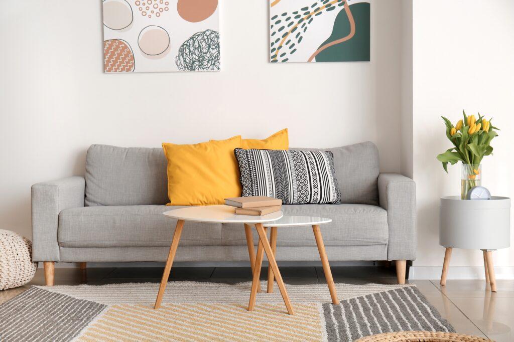 Gray Den Sofa with Golden Pillows and Creatively Pieced Rug