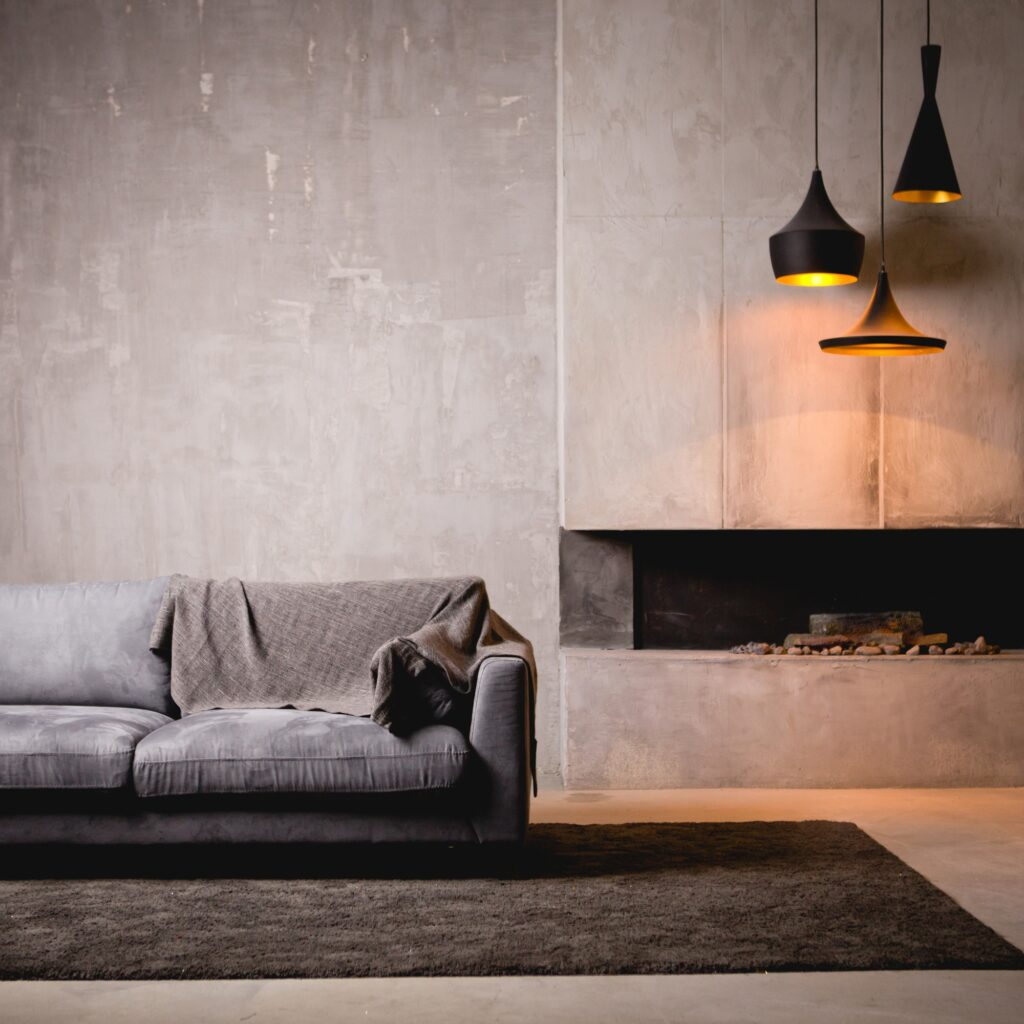 Gray Velour Living Room Sofa with Faux Fireplace and Pendant Lamps