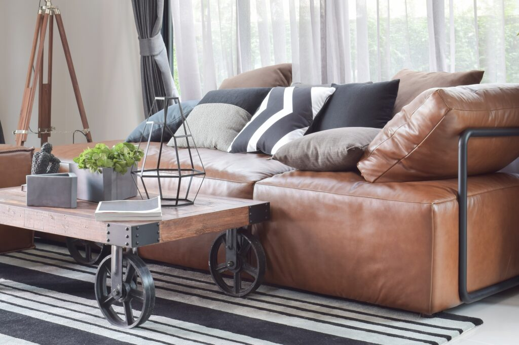 Industrial Style Interior with Brown Leather Couch and Classic Curtains