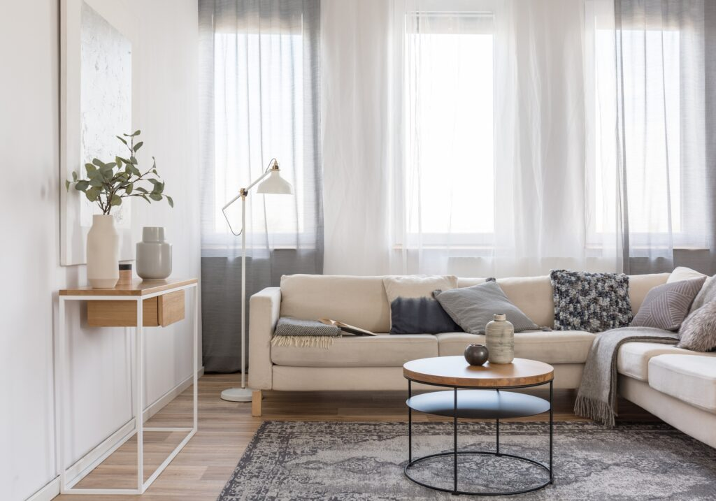 Large Beige Sectional Sofa with Decorative Pillows and Rug in Family Room