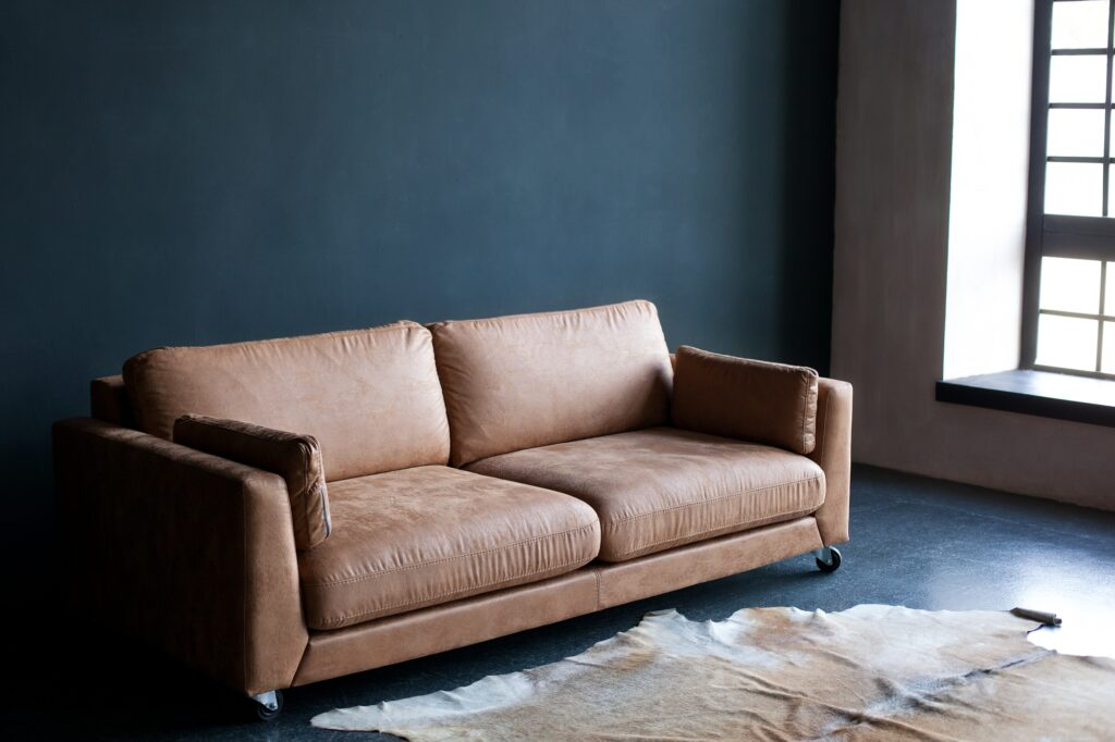 Light Brown Leather Couch with Leather Carpet in Grunge Style Interior