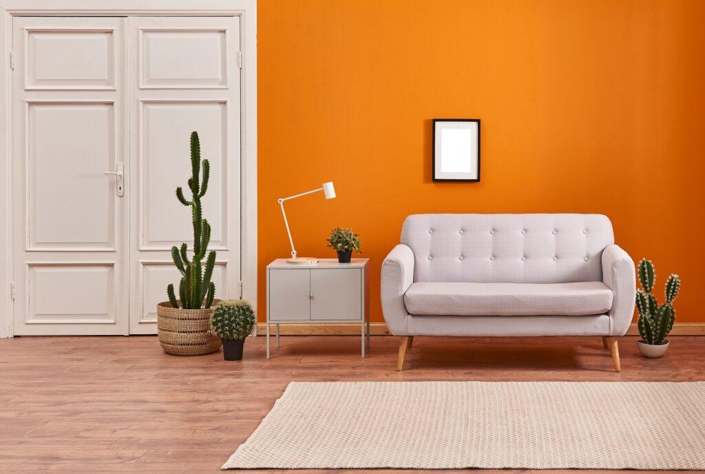 Light Gray Living Room Sofa Against Orange Wall with Natural Fiber Rug