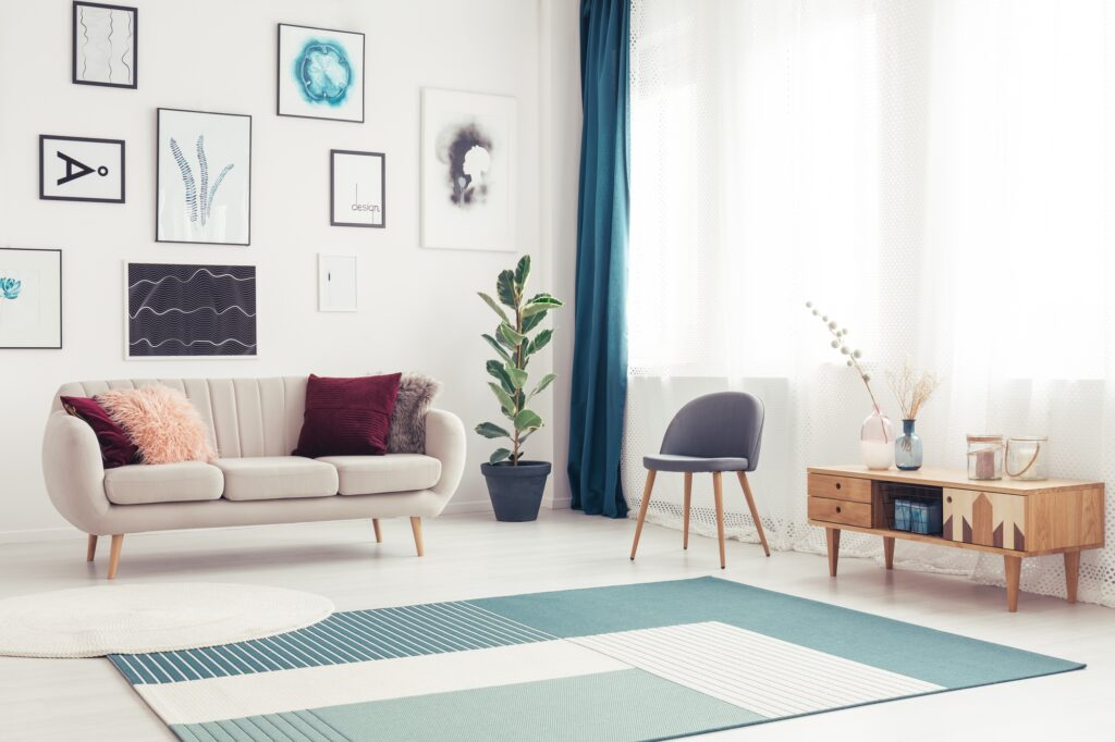 Living Room View with Blue Green Rug and Elegant Beige Sofa