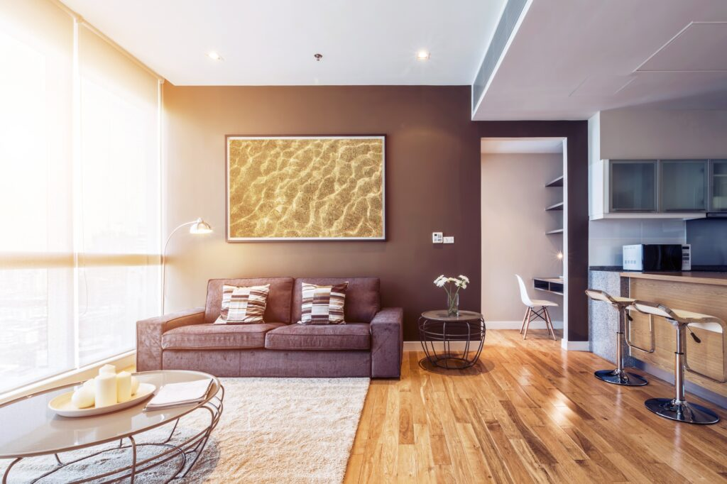 Living Room with Stylish Brown Couch Beige Patterned Rug and Window Wall