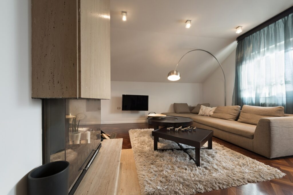 Loft Apartment Living Room With Light Brown Couch and Fireplace