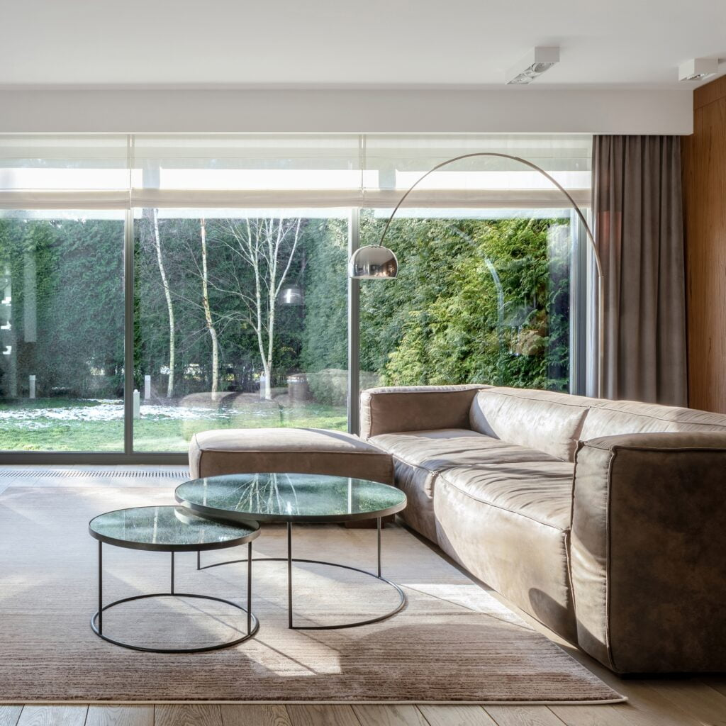 Luxurious Modern Living Room with Streamlined Decor and Splendid View