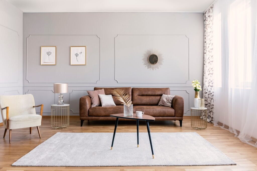 Minimalist Living Room Design with Brown Leather Couch and Sedate Grey Rug