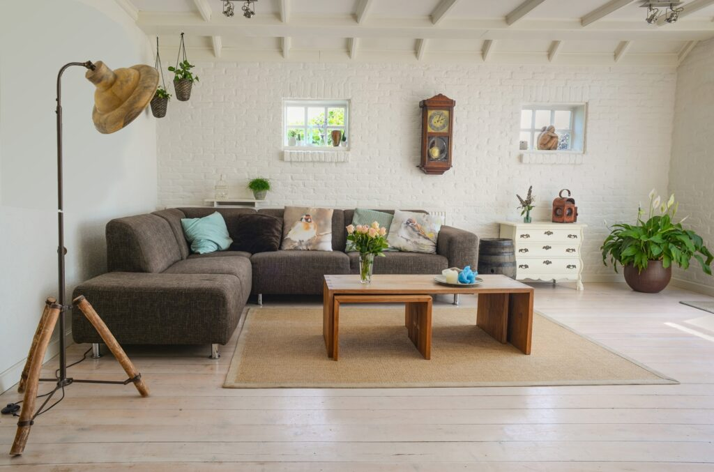 Modern Boho Living Room with Brown Sectional Couch and Pumpkin Colored Rug