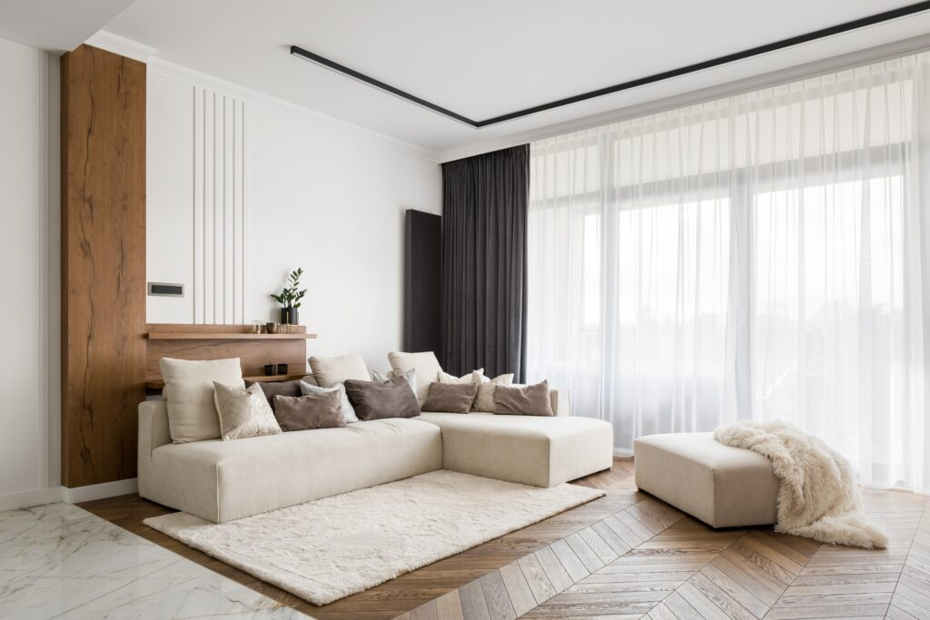 Modern Living Room with Large Beige Corner Sectional Sofa and Tall Windows