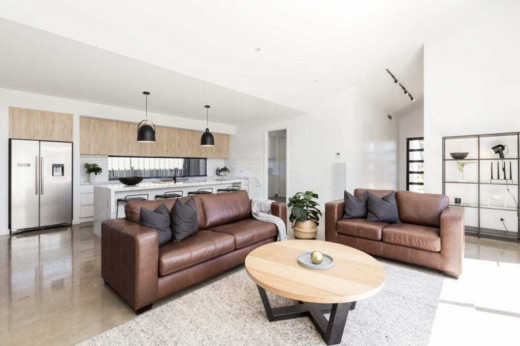 Open Plan Scandinavian Style Living Room with Brown Couches
