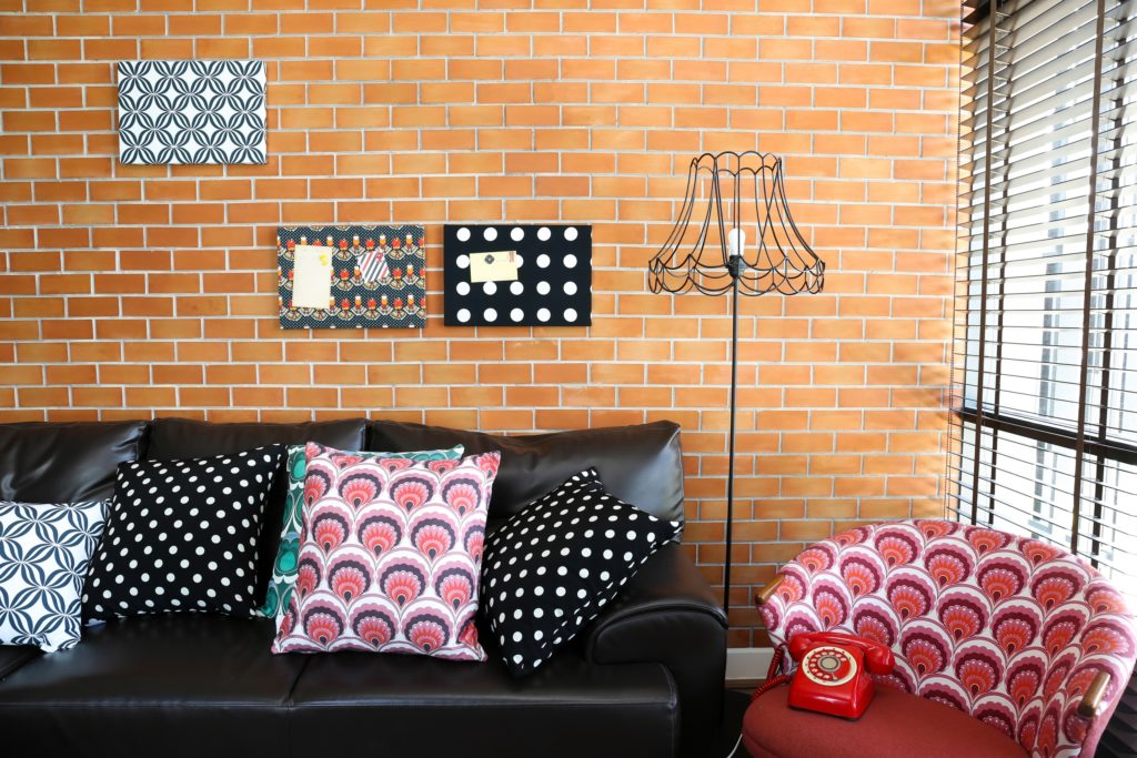 Patterned Pillows on Black Sofa