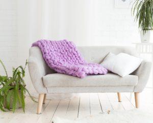 Purple Blanket on Gray Sofa