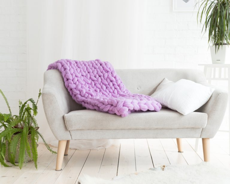 Purple Blanket on Gray Sofa