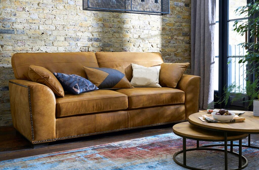 Rustic Living Room with Golden Brown Couch Antique Brick Wall and Colorful Rug