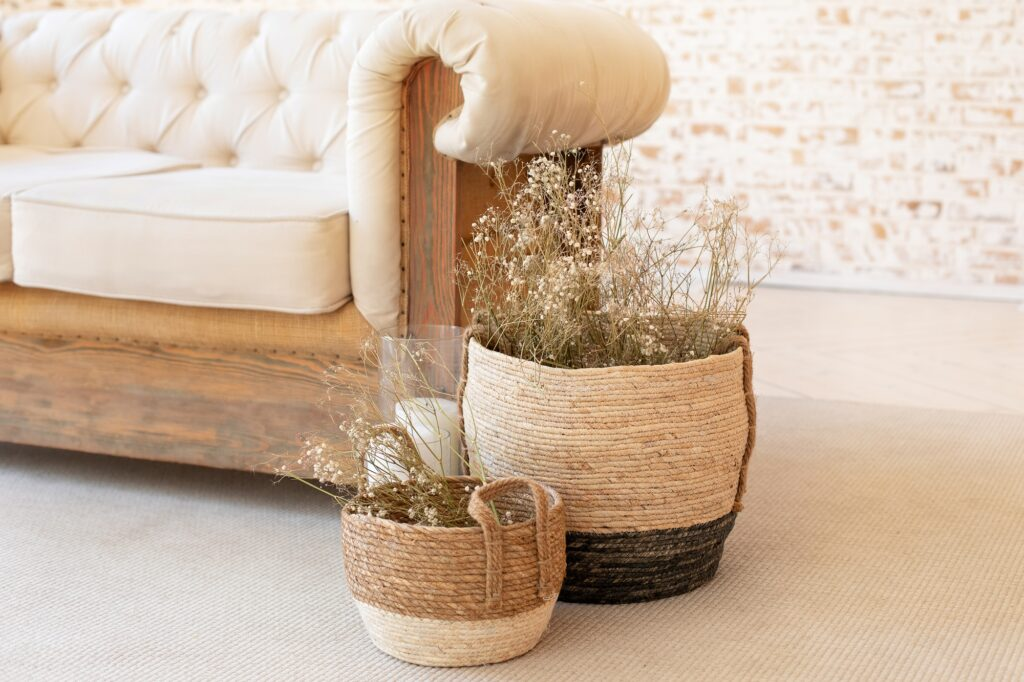 Rustic Scandinavian Living Room with Baskets Dried Flowers and Vintage Beige Sofa