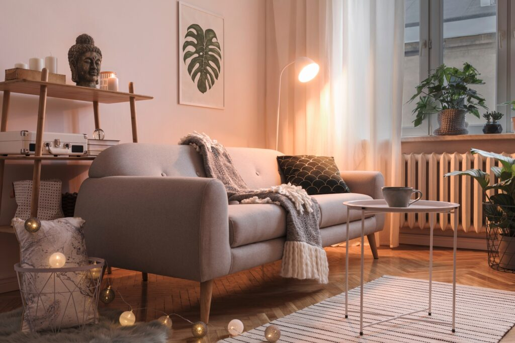 Scandinavian Style Brown Sofa in a Warm Interior with Woven Rug