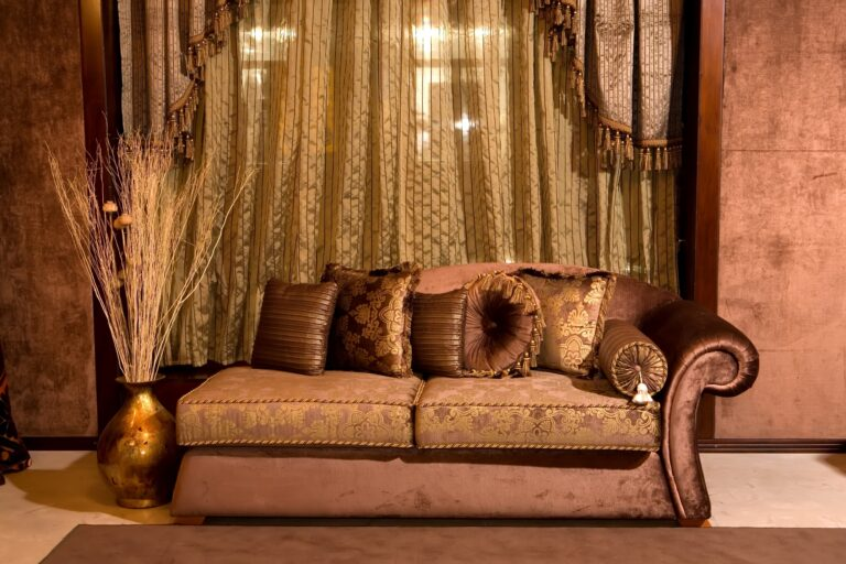 Shabby Chic Interior with Ornate Brown Sofa and Accessories