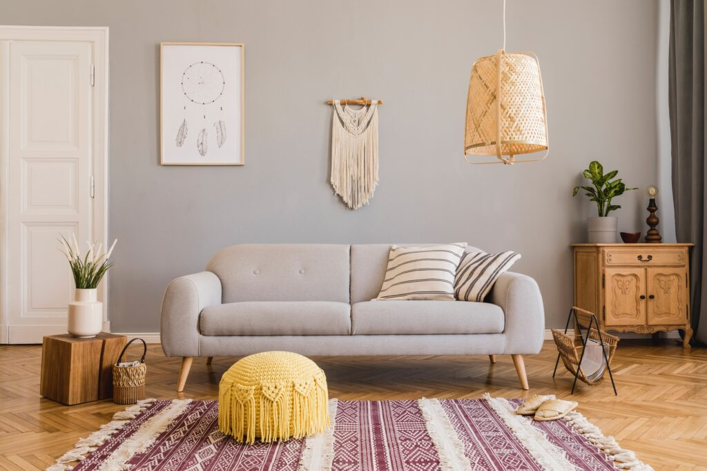Stylish Den Interior with Gray Sofa and Craft Style Rug in Auburn and White Hues