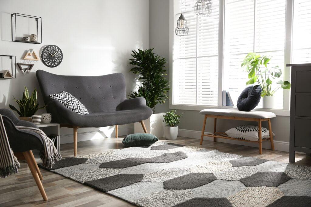 Stylish High Backed Charcoal Gray Living Room Sofa and Designer Rug