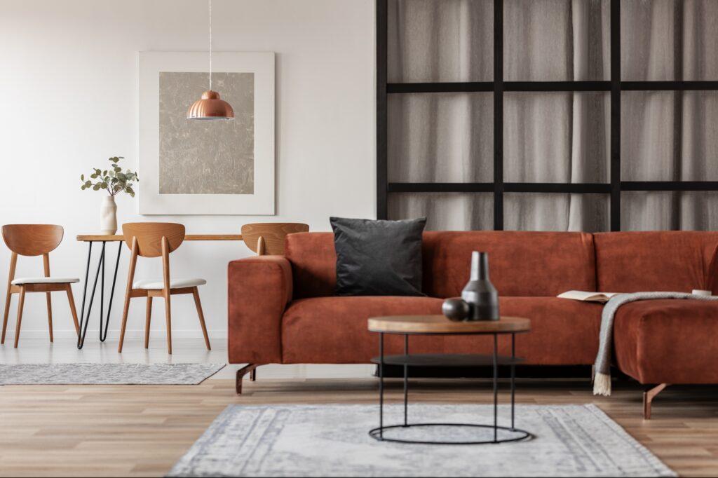 Trendy Modern Living Room with Bright Brown Corner Sofa