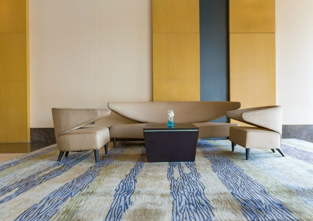 Ultra Modern Interior with Abstract Brown Couch and Multi Colored Rug